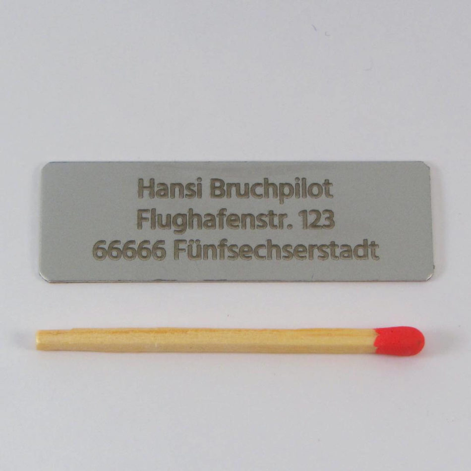 Aluminiumschild 3zeilig 50×16 (alufarben/0,50)